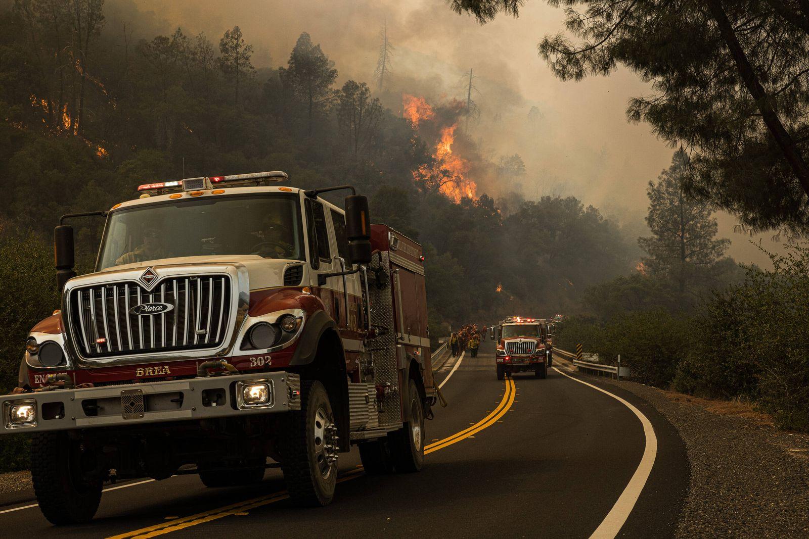 August 20, 2020, Mocassin, California, U.S: Fire crews move along Hwy 49 as the MocFire burns near San Franciscos Hetch