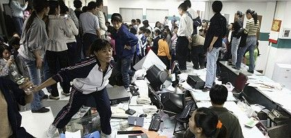 Factory workers smashed up an office during a protest at Kaida toy factory in Dongguan, Guangdong province in November.