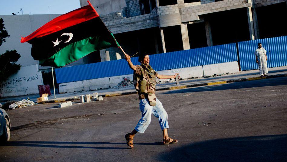 Jubel in Tripolis: Die Rebellen erhalten Gaddafis Geld