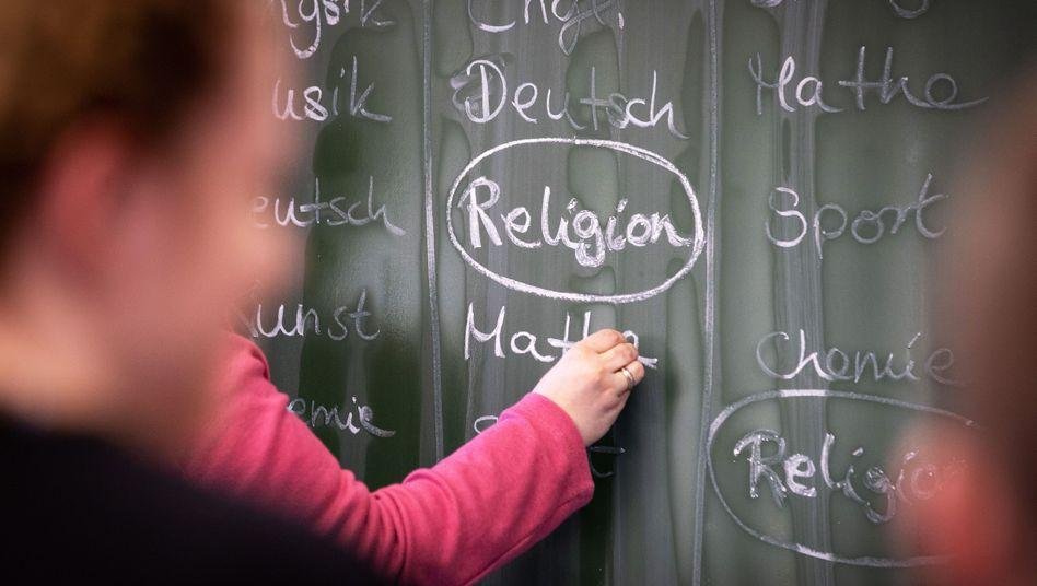 Konfessioneller Religionsunterricht oder Gemeinschaftsunterricht?