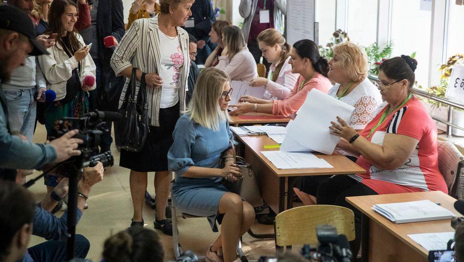 Ein Oppositionsaktivist bei der Wahl: Dutzende Oppositionelle und Kremlkritiker waren als Kandidaten von der Abstimmung ausgeschlossen worden
