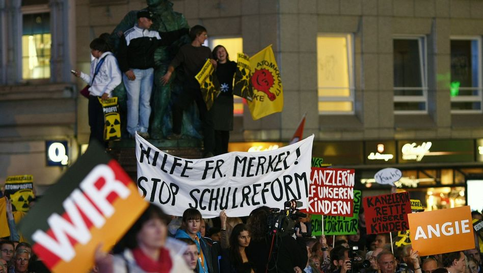 Hecklers were among those at a rally given by Chancellor Angela Merkel last Friday.
