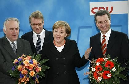 German Chancellor Angela Merkel with the premier of Saxony-Anhalt, Wolfgang Boehmer and Guenther Oettinger, premier of Baden-Wuerttemberg.