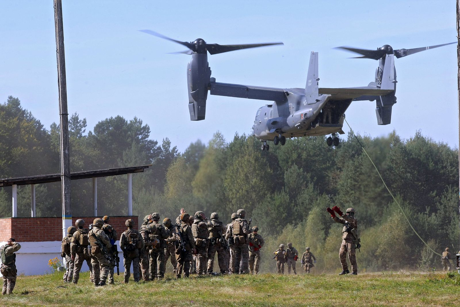 VINNYTSIA REGION, UKRAINE - SEPTEMBER 19, 2020 - Soldiers partake in a fast rappelling exercise from a Bell V-22 Osprey