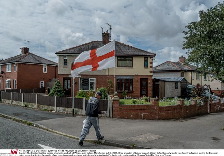 The English flag flying outside of a home in Wigan