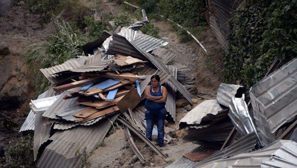 Zerstörtes Haus in El Cambray II: Regen behindert Rettungsarbeiten