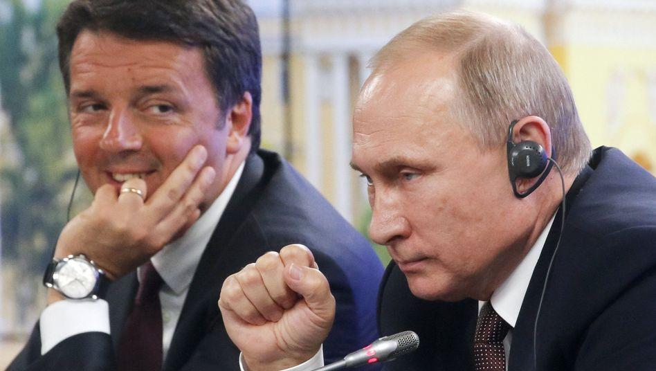 Politiker Putin (r.), Renzi