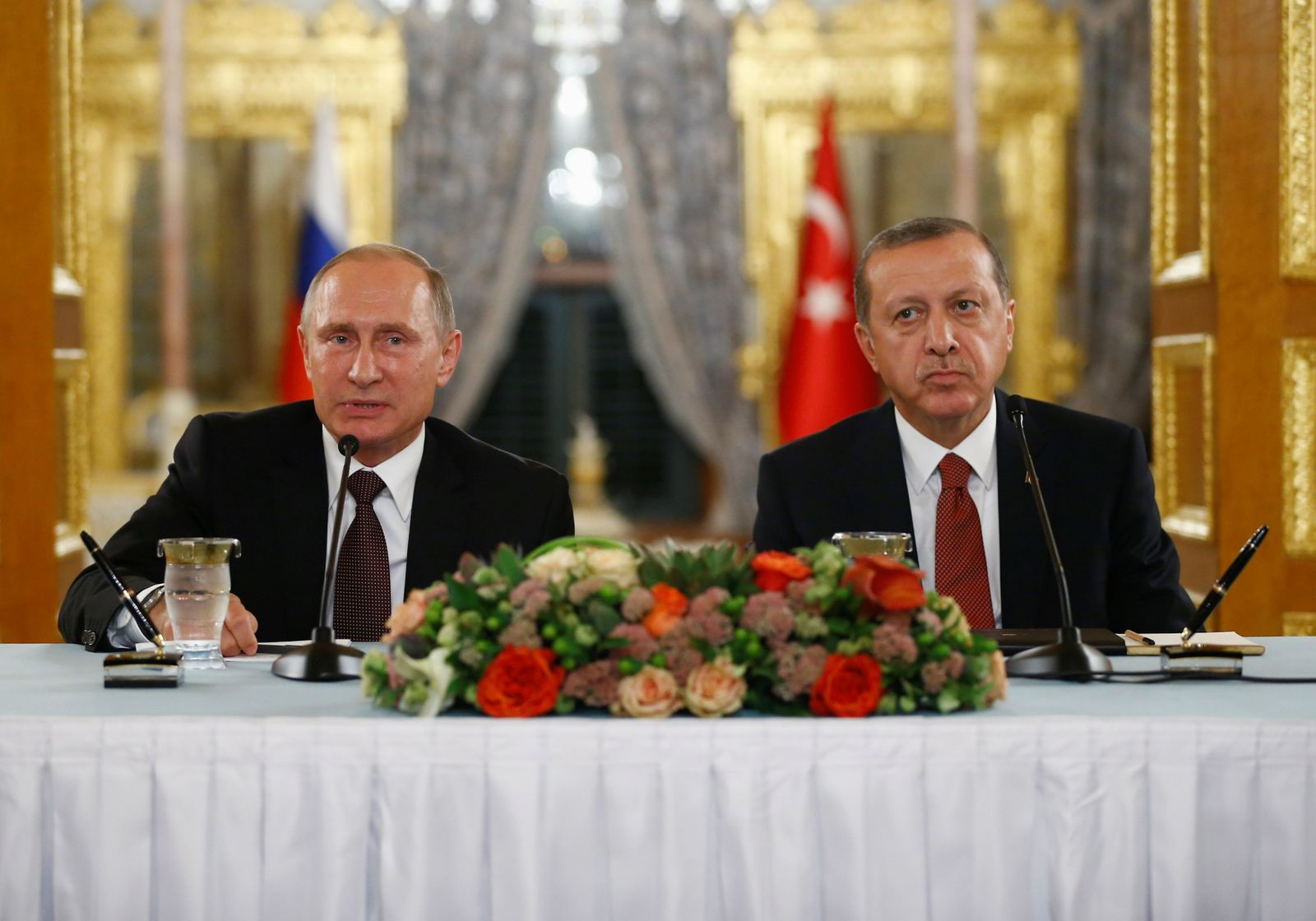Russian President Putin talks during a joint news conference with his Turkish counterpart Erdogan following their meeting in Istanbul