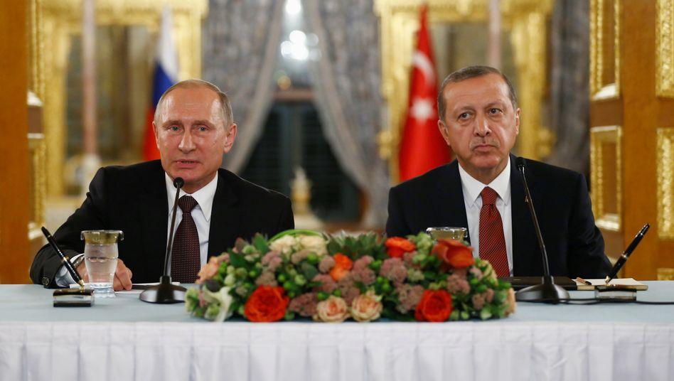 Kämpfen in Idlib um Syrien: Recep Tayyip Erdogan und Wladimir Putin