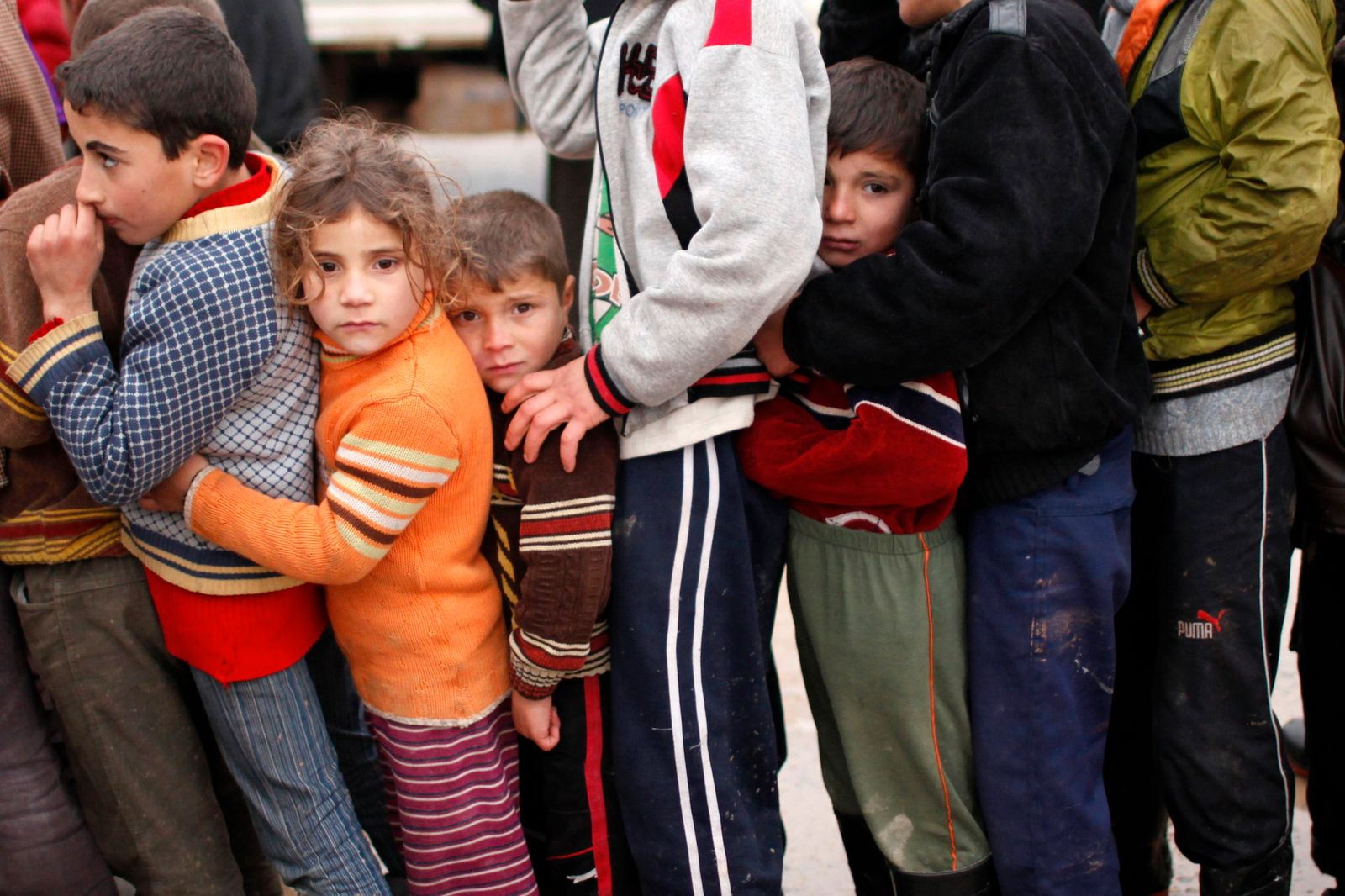 File photo of Syrian refugee children queuing as they wait to receive aid from Turkish humanitarian agencies at Bab al-Salam refugee camp in Syria near the Turkish border