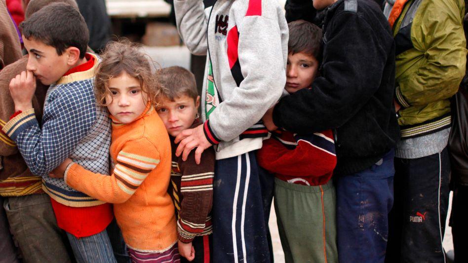 Geflüchtete Kinder aus Syrien (Archivbild): Nicht nur Gewalt belastet Kinder