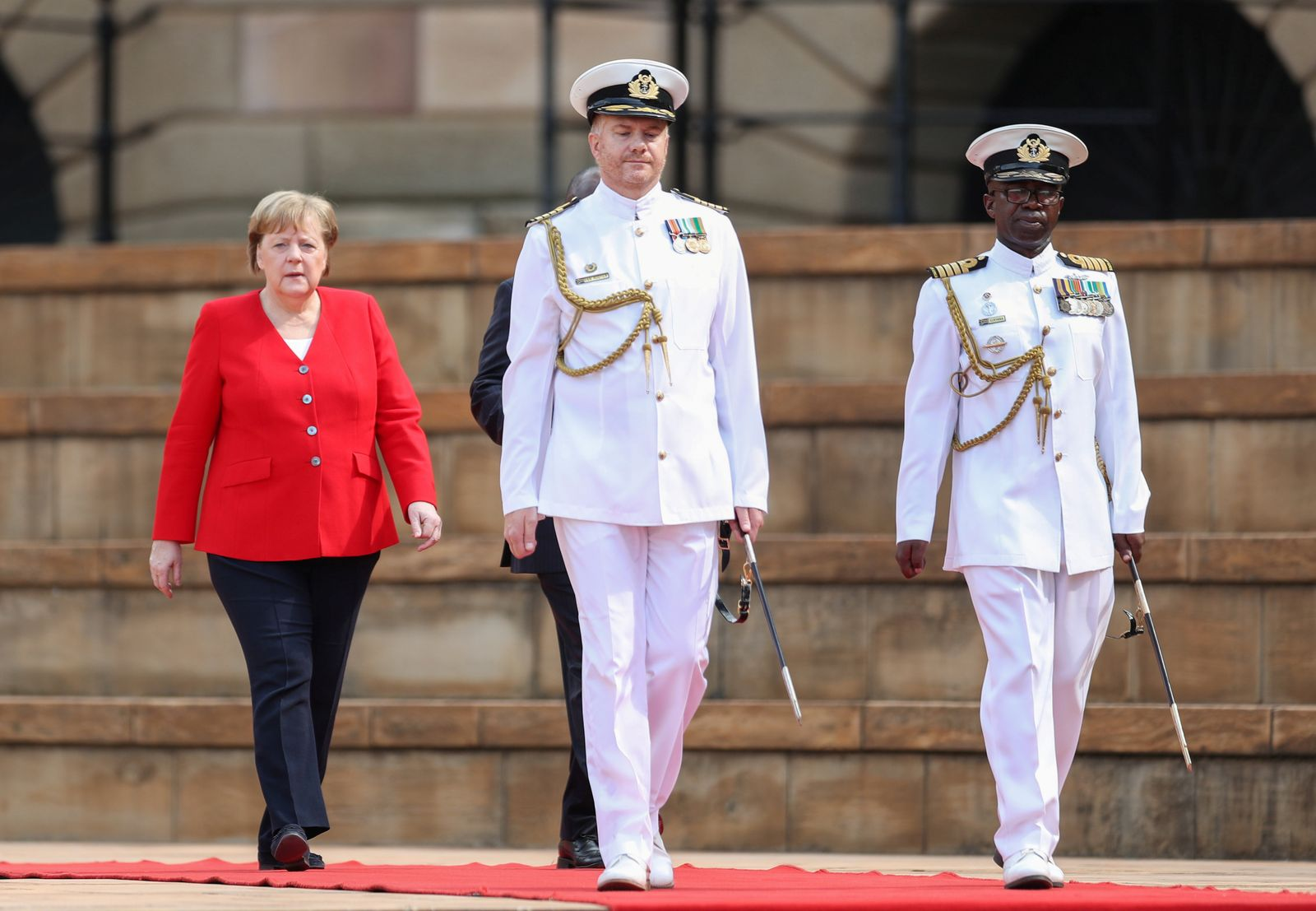 German Chancellor Angela Merkel, arrives with South Africa's President Cyril Ramaphosa, for her state visit at the Union Buildings in Pretoria