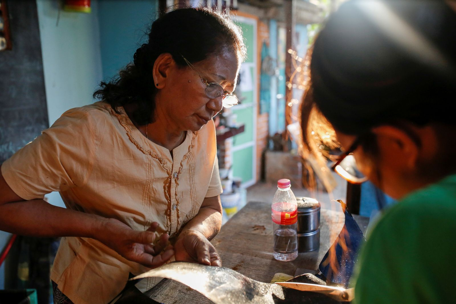 Wendy works on recycled materials at a workshop at ChuChu house in Dalla township, Yangon