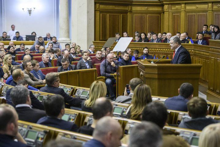 Ukrainian President Petro Poroshenko speaks during an extraordinary Parliament session in Kiev.