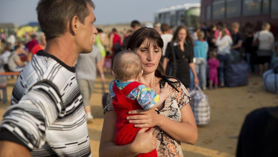 Ukrainische Flüchtlingsfamilie: Weg aus dem Kampfgebiet