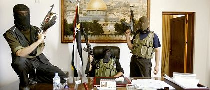 Hamas fighters pose in Palestinian President Mahmoud Abbas' personal office after they captured it in Gaza.