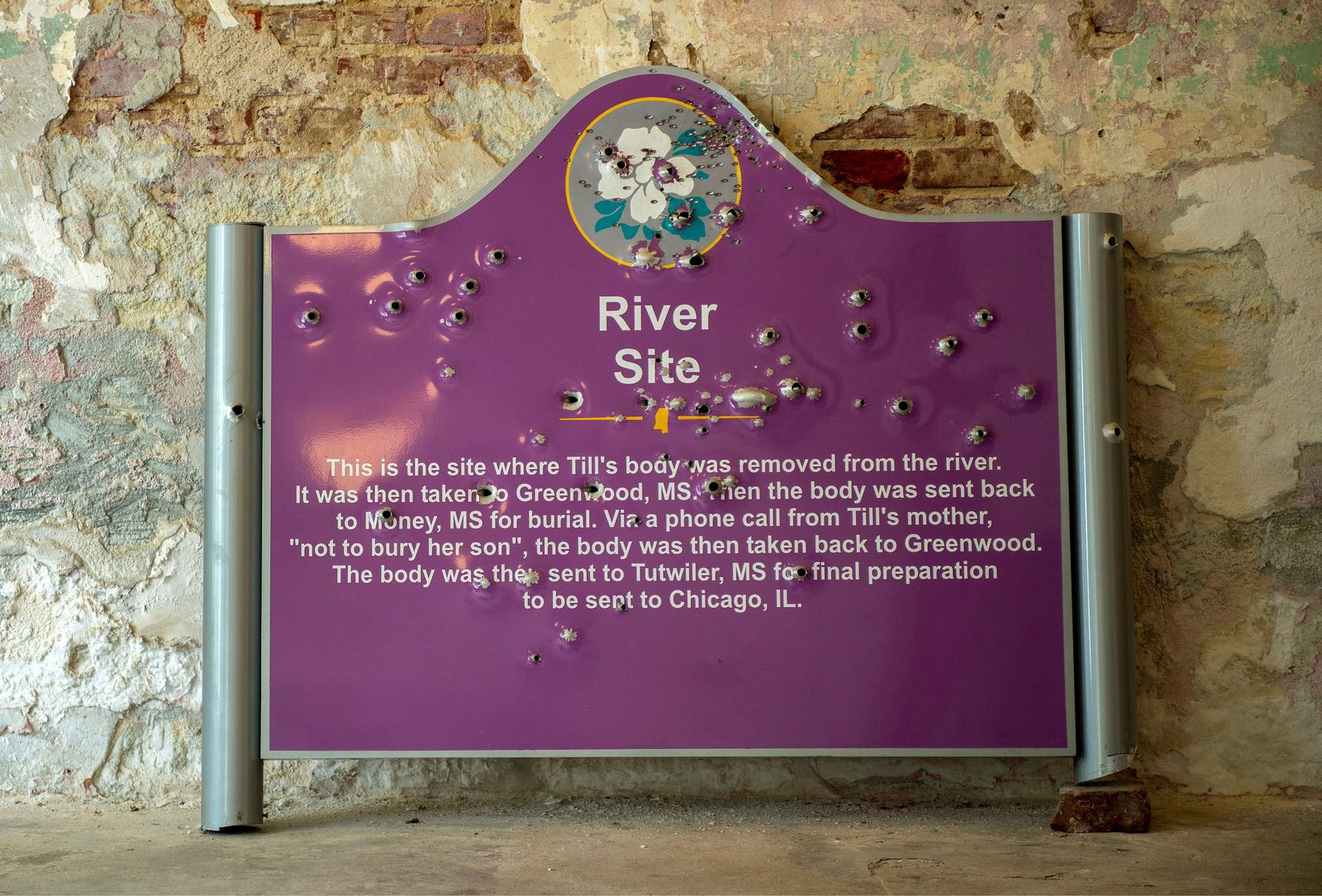 The sign marking the river where Emmett Till's body was found is moved to the Emmett Till Interpretive Center after it was vandalized, in Sumner, Miss., July 19, 2018. (Robert Rausch/The New York Times)