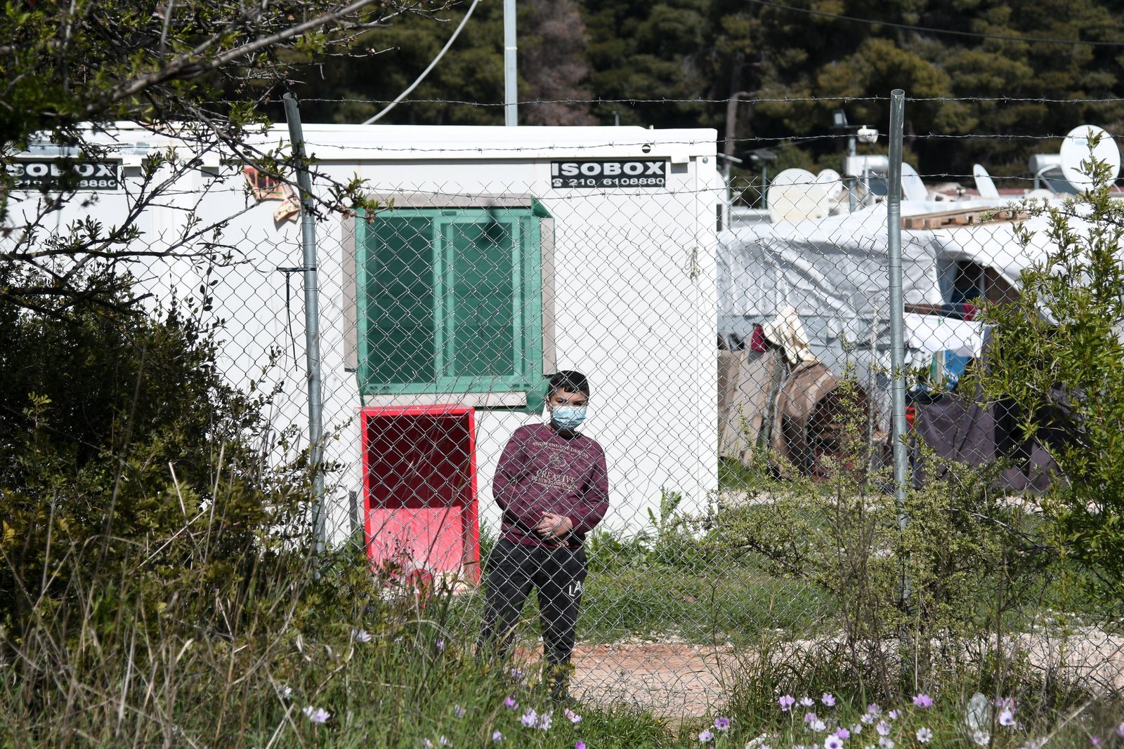 Greek health officials have placed a refugee and migrant camp northeast of the capital in quarantine after 20 of its res