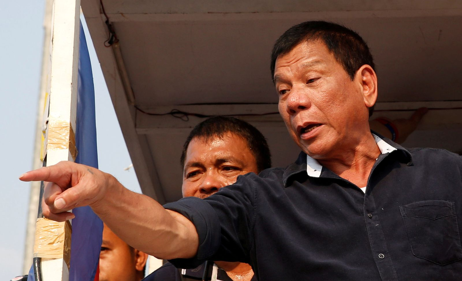 """FILE PHOTO: Presidential candidate Rodrigo """"Digong"""" Duterte greets supporters during election campaigning in Malabon, Metro Manila"""