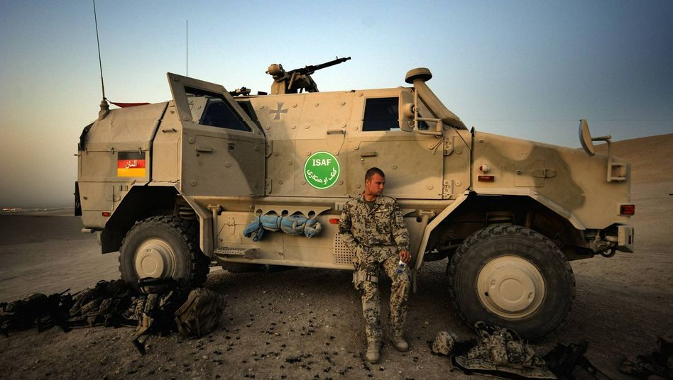 A German soldier and his Dingo armored vehicle: Paratroopers complained that they had no access during training to some of the vehicles they would be using in Afghanistan.