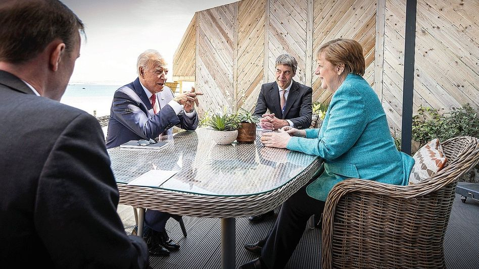 U.S. President Joe Biden and German Chancellor Angela Merkel with advisers at the G-7 meeting in St Ives, England, in June: Some of the goodwill has been used up