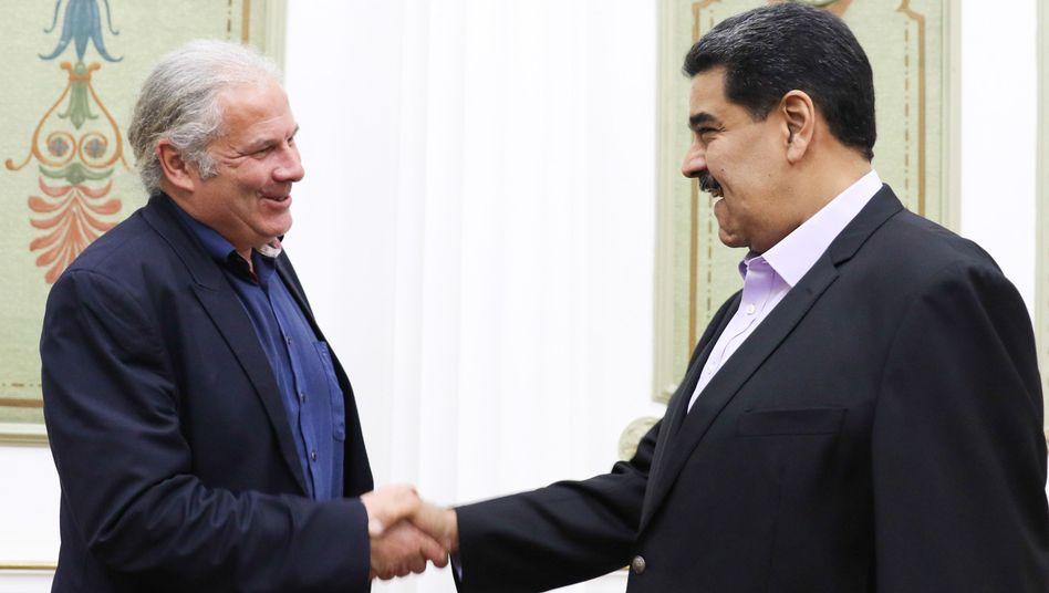 Andrej Hunko (l.) und Nicolás Maduro auf einem Bild, das der Präsidialpalast Miraflores veröffentlichte