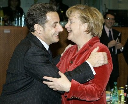 French President Nicolas Sarkozy and German Chancellor Angela Merkel helped to negotiate a compromise climate deal on Friday that is winning approval, however tepid, from the German press.