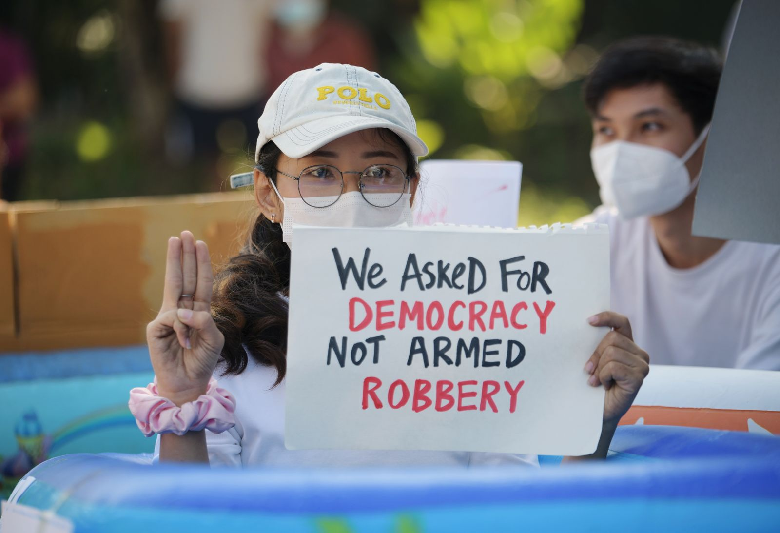 People protest against the military coup and to demand the release of elected leader Aung San Suu Kyi, outside the Japanese Embassy in Yangon