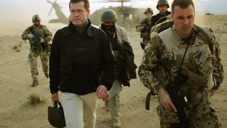 Guttenberg (in Afghanistan Anfang November): Neuer Orden für deutsche Soldaten