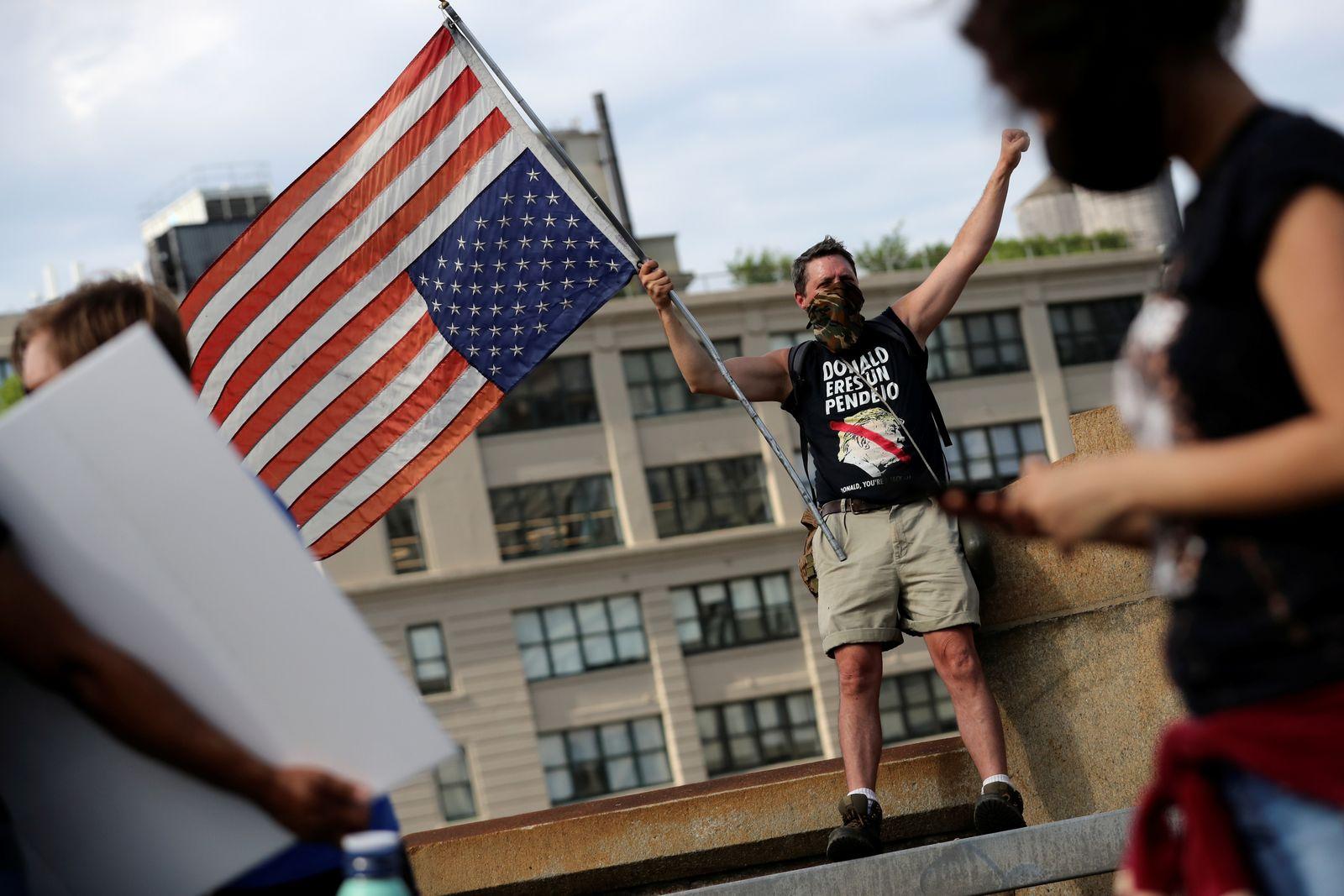 Demonstrators march across Brooklyn Bridge against the death in Minneapolis police custody of George Floyd in Brooklyn New York