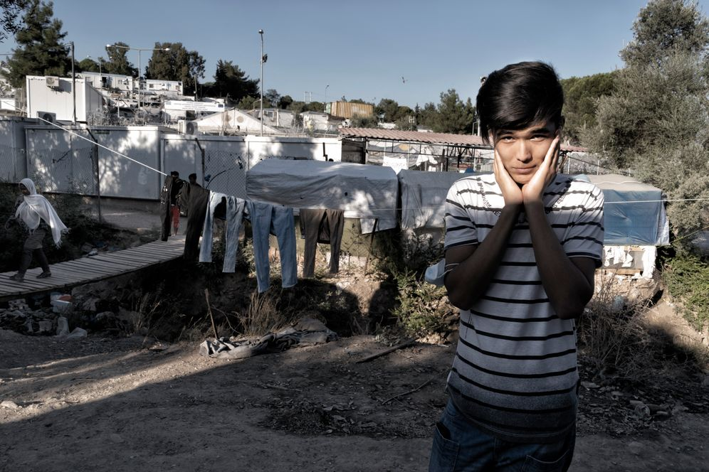 Mohammad, a refugee from Afghanistan, standing in the Moria camp on the island of Lesbos. He has no contact to his parents.