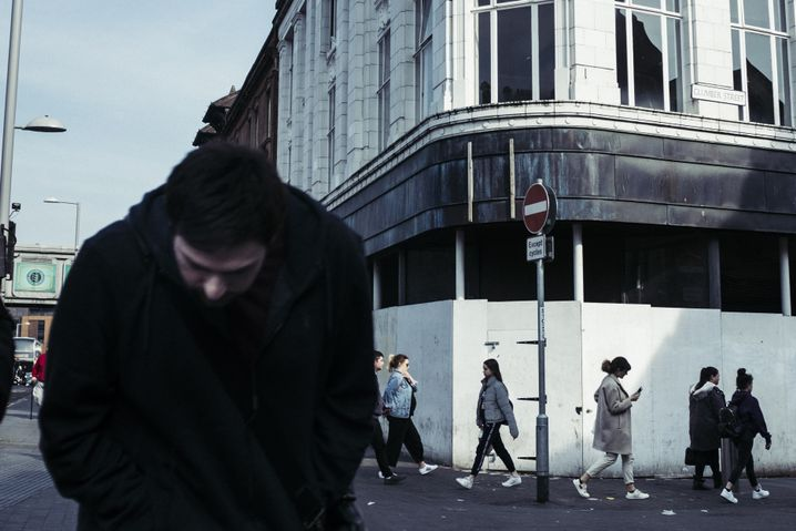 Passersby in a shopping street in downtown Nottingham