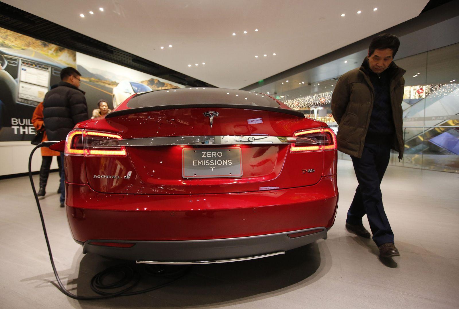 A man looks at Tesla Motors' Model S P85 at its showroom in Beijing