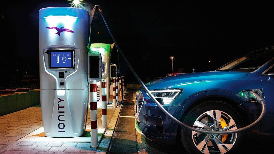 "An Audi e-tron at a charging station: ""The lever has been flipped."""