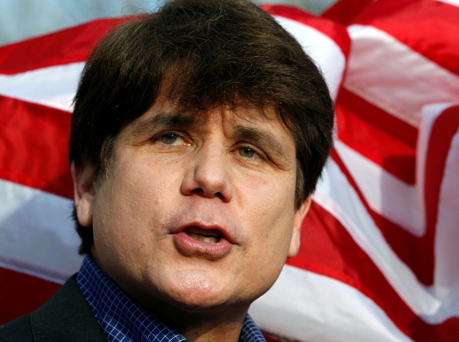 FILE PHOTO: Former Governor of Illinois Blagojevich makes a statement to reporters outside his Chicago home