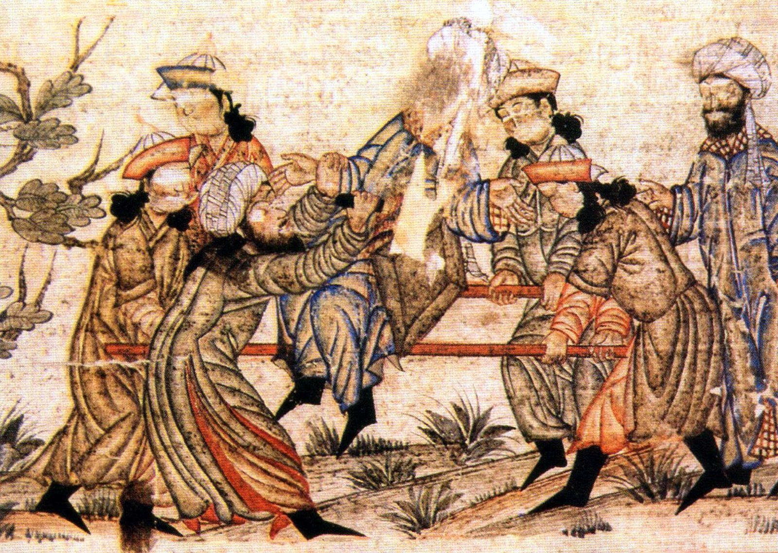 Iran / Persia: The assassination of Nizam al-Mulk by an assassin of Hassan-i-Sabbah, 1092 CE. Miniature at the Topkapi Palace, Istanbul, Turkey.