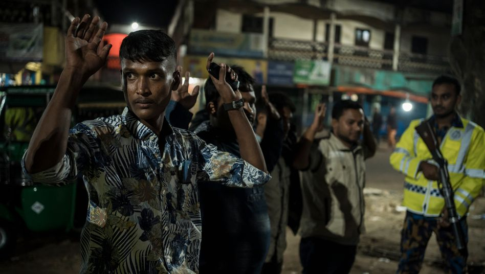 A police anti-drug unit stopping people in southern Bangladesh