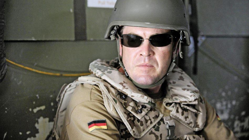 Verteidigungsminister Guttenberg: Gern in guter Pose