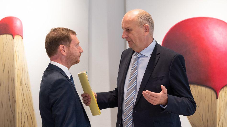 Wollen weiterhin regieren: Sachsens Ministerpräsident Michael Kretschmer (CDU, links) und Brandenburgs Regierungschef Dietmar Woidke (SPD)