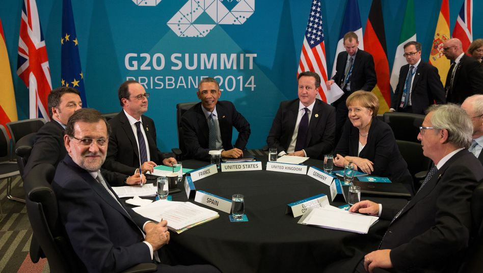 Mächtige Runde: Kanzlerin Merkel mit anderen Staats- und Regierungschefs