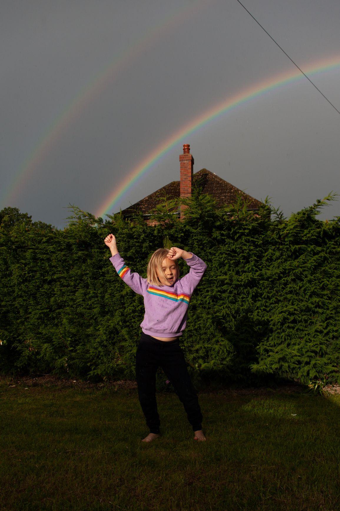 Rainbow Magic. A Girl Dances In The Rain.
