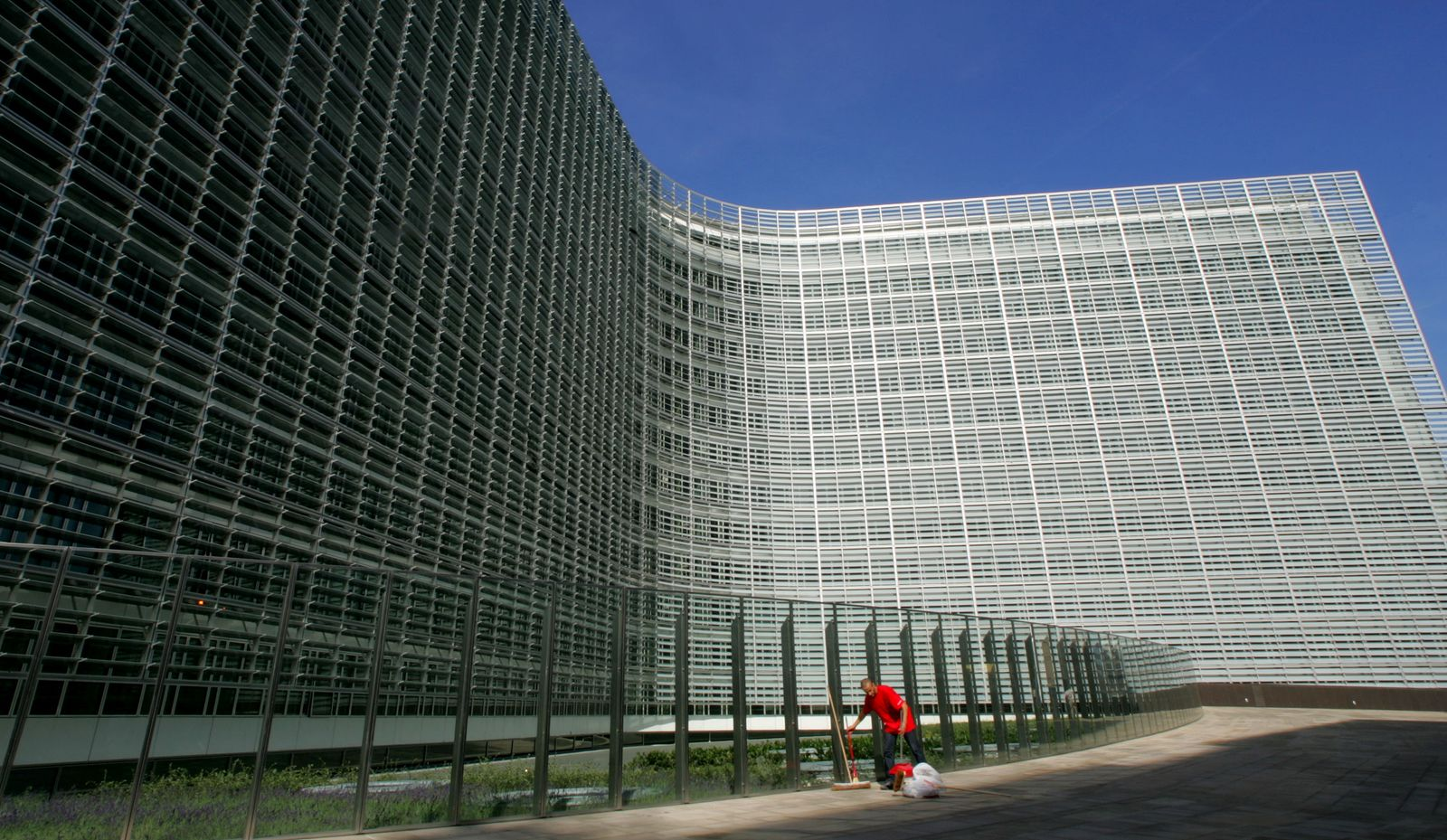 A worker cleans outside the future headquarters of the European Commission in Brussels.