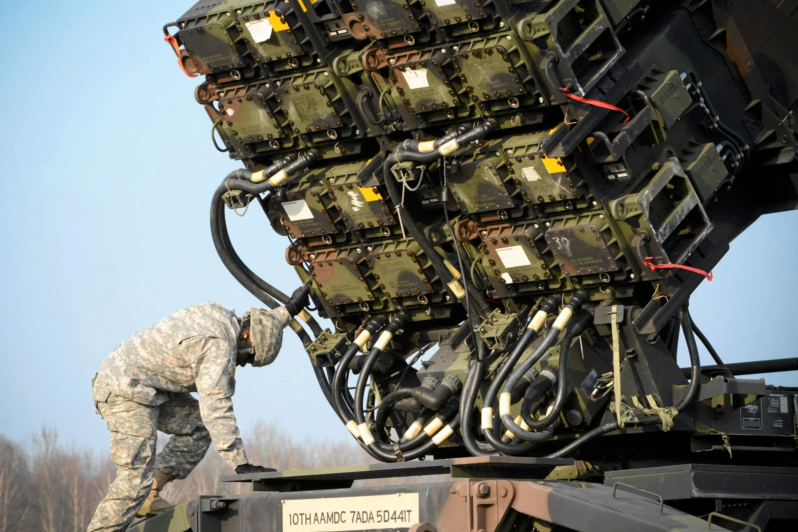 A U.S soldier inspecys a Patriot missile defence battery during join exercises at the military grouds in Sochaczew