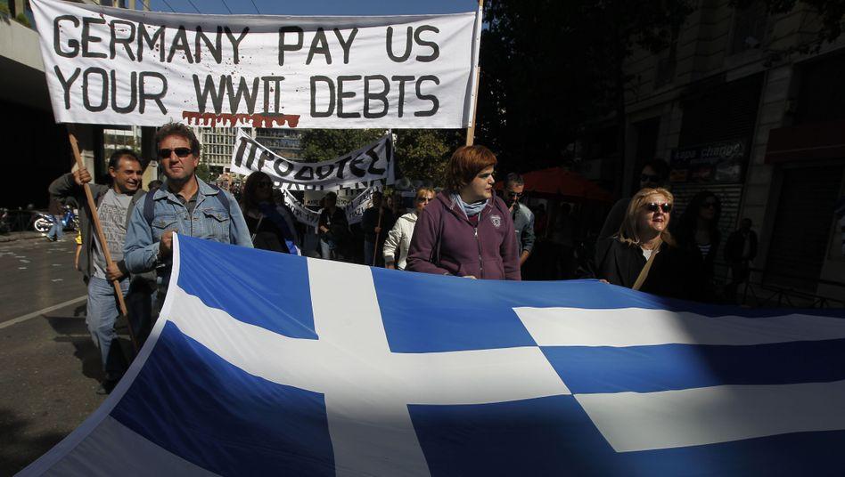 Greek demonstrators protesting tough cutbacks in Athens.
