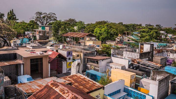 Wohnungsnot in Manila: Leben auf dem Friedhof