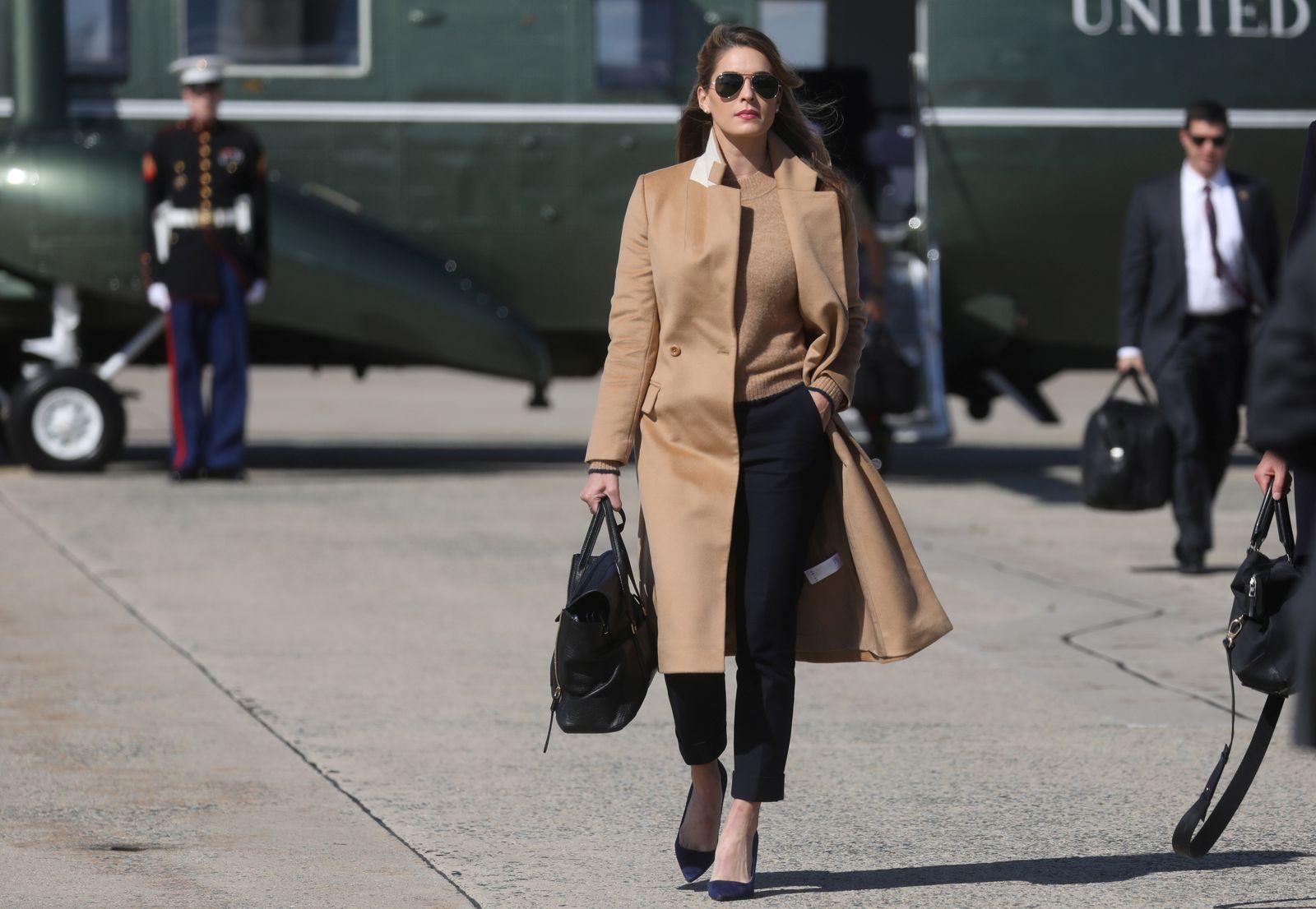 Hope Hicks, an advisor to President Trump walks to Air Force One to depart Washington