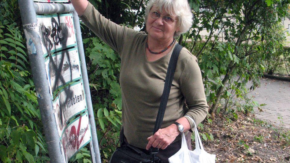 Irmela-Mensah Schramm has been scraping away Nazi slogans for 20 years.