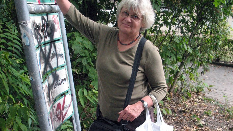 Irmela-Mensah Schramm has been scraping away Nazi slogans for 20 years.