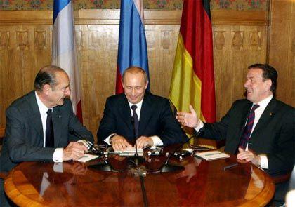 Neues europäisches Machtdreieck: Frankreichs Staatschef Jacques Chirac, Russlands Präsident Wladimir Putin und Bundeskanzler Gerhard Schröder