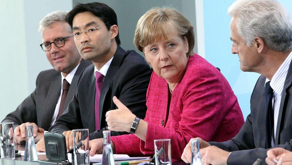 Koalitionäre Röttgen, Rösler, Merkel, Ramsauer: Ökoattacke auf die Grünen